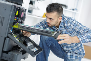 technician fix the printer by screwdriver