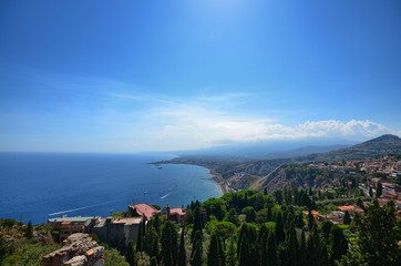 Taormina, Italy, Sicily August 26 2015. The splendid panorama from the Greek theater, towards the sea. Lush nature, Mediterranean vegetation, flowers. Sea and boats.