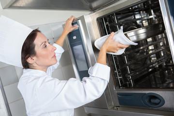 portrait of happy female cook at restaurant kitchen