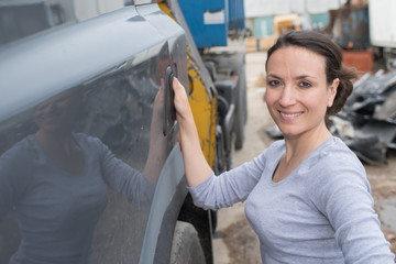 female car mechanics repairing a car
