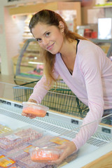 Lady choosing from supermarket counter