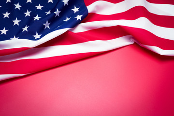 Closeup of American flag on red background.