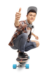 Teenager with a longboard making a thumb up sign