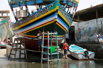 Fishermen go about their day at the fishing port of the Red Sea city of Hodeida, Yemen
