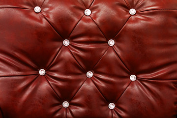Red leather sofa texture background.