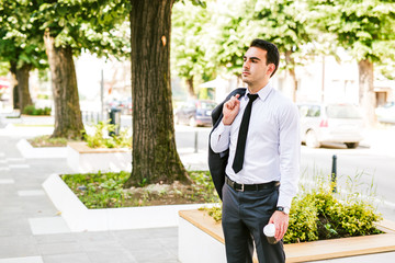 Young businessman take break to drink coffee at the avenue