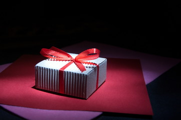 Gift box on a black background.