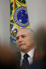 Brazil's President Michel Temer reacts during a ceremony to announce the resumption of works of urban mobility in the city of Goiania, at the Planalto Palace in Brasilia