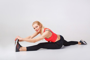 woman in sportswear does exercises