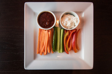Fresh carrot cucumber pepper and two sauce. Healthy food. Low-Carb Diet. Vegetarian food.