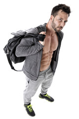 Sexy muscular guy with sport bag standing in front of white background
