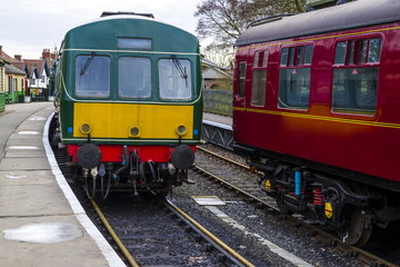 Class 101 DMU. Heritage Diesel Multiple Unit, alongside a passenger carriage in a 1930's styled station.