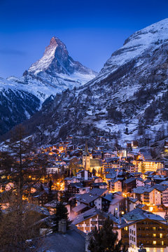 The world-famous Matterhorn glows in the early morning above the Swiss village of Zermatt, as the sun prepares to rise over the Alps.