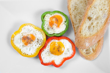 Colourful pepper with eggs and bread