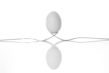 One egg on two forks