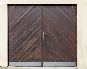 Wooden gate of dark color from boards.