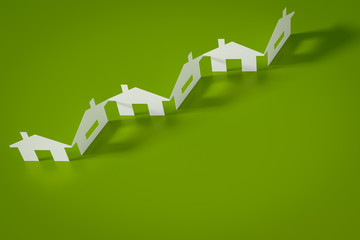 a paper cutout row of houses green background