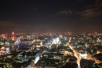 Cityscape of London illuminated at night, United Kingdom, Europe