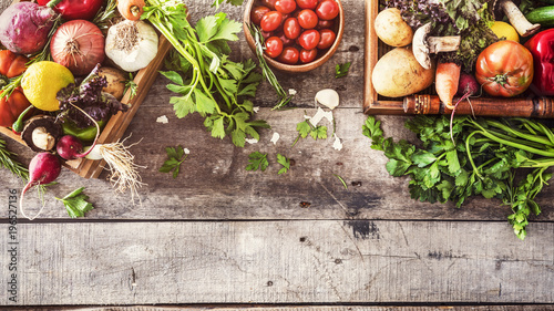 Wall mural Organic vegetables healthy nutrition concept on wooden background