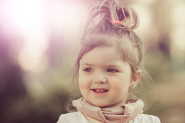 Kid model with long healthy hair ponytail on sunny day