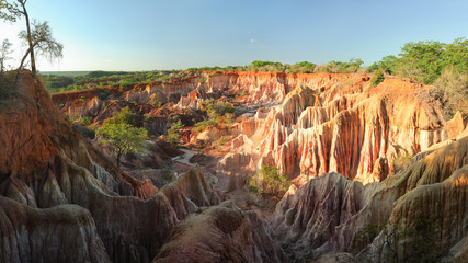 Marafa Depression (Hell's Kitchen canyon) with red cliffs and rocks in afteroon sunset light. Malindi, Kenya