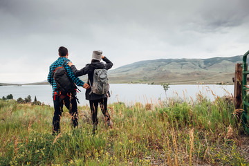 Couple near Dillon Reservoir, looking at view, Silverthorne, Colorado, USA