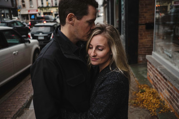 Couple embracing in street