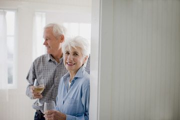 Senior woman and her husband inside their home.