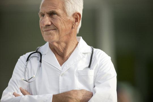 Portrait of senior doctor looking worried.