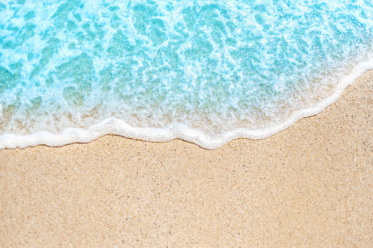 Summer background with Soft wave of blue ocean on sandy beach
