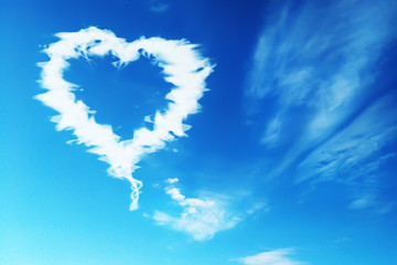 blue sky with cloud in the shape of a heart
