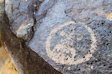 Angry face petroglyph