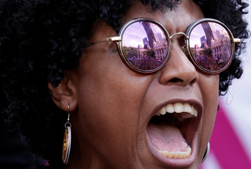 A demonstrator reacts during the wake of Rio de Janeiro's city councillor Marielle Franco, 38, and her driver Anderson Gomes who were shot dead, outside the city council chamber in Rio de Janeiro