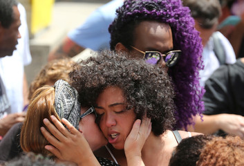 Demonstrators react before the wake of councilwoman Marielle Franco, 38, who was shot dead, in Rio de Janeiro