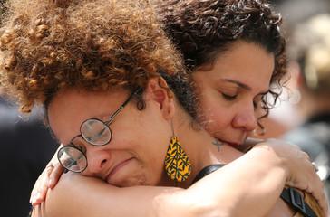 Demonstrators react before the wake of councilwoman Marielle Franco, 38, who was shot dead, in Rio de Janeiro