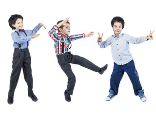 Collage. A happy boy in different clothes and a black wig dances. Isolated. White background.