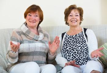 Happy senior women posing indoors and  laughing