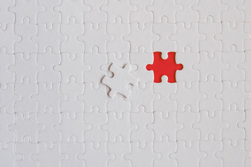 Wall Mural - White details of jigsaw puzzle on red background