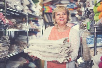 mature woman buying tablecloths