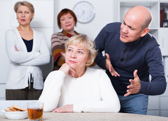 Mature man is apologizing to girlfriend for quarrel