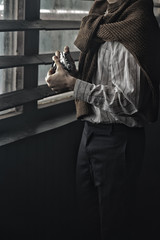 man holds a vintage film camera.