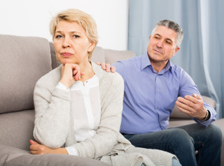 resentful mature couple quarreling at home with each other