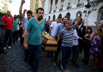 Brazil's presidential pre-candidate of the Socialism and Freedom Party (PSOL) Guilherme Boulos helps to carry the coffin of councilwoman Marielle Franco outside the Legislative Assembly in Rio de Janeiro