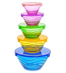 Stack of colorful glass food containers with plastic lid isolated on white background.