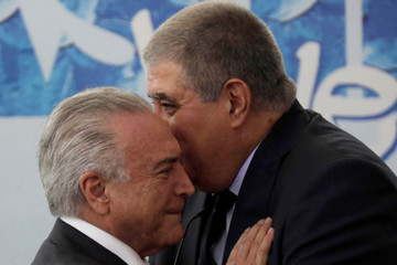 Brazil's President Michel Temer talks with Brazil's Minister of the Government Secretariat Carlos Marun during a ceremony to announce the decree regulating the National Youth System (Sinajuve), at the Planalto Palace in Brasilia