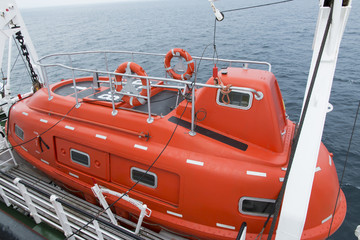 closed lifeboat on a ship