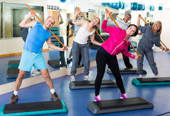 Group of people exercising in a fitness club