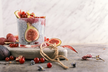Chia smoothie, figs and coconut milk decorated with currants