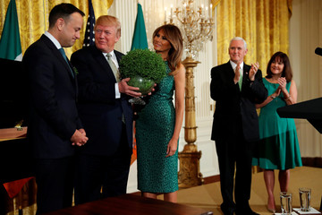 U.S. President Donald Trump, flanked by first lady Melania Trump, Vice President Mike Pence and his wife Karen Pence, receives a bowl of shamrocks from Ireland's Prime Minister, Taoiseach Leo Varadkar during a St. Patrick's Day reception at the White House