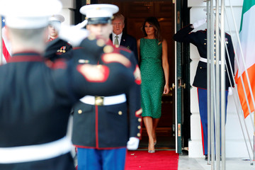 U.S. President Donald Trump and first lady Melania Trump walk out to greet Ireland's Prime Minister, Taoiseach Leo Varadkar for a St. Patrick's Day reception at the White House